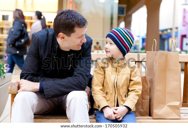 happy family of two looking at each other after shopping together