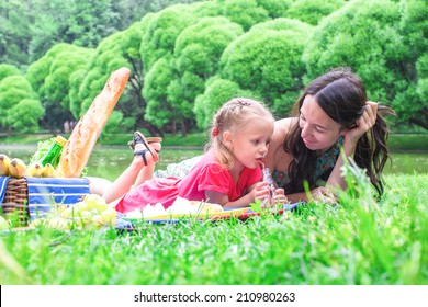 Happy family of two picnicking in the park outdoor