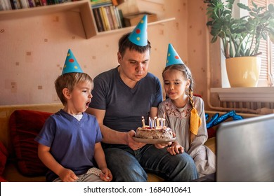 Happy family with two sibling celebrating birthday via internet in quarantine time, self-isolation and family values, online birthday party