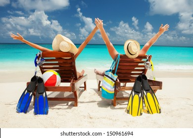 Happy family vacation at Paradise. Couple relax on the white sand of beach. Happy sea lifestyle. Young family, man and woman rest on the beach of ocean. Couple in love travel to island. Love travel
