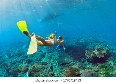 Happy family vacation. Young couple in snorkeling mask hold hand, free dive underwater with fishes in coral reef sea pool. Travel lifestyle, watersport adventure, swim activity on summer beach holiday