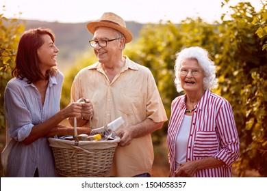 Happy family in vineyard before harvesting