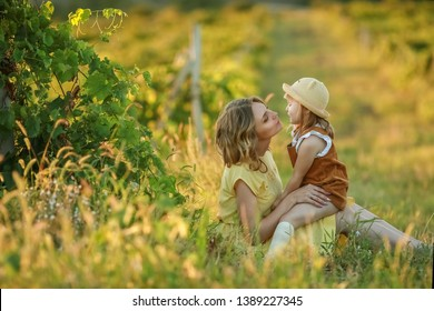 A Happy family walking history. mother and baby hugging in a meadow yellow flowers on nature in summer.