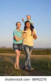 Happy Family walking outdoors