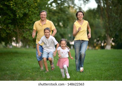 happy family walking in the park
