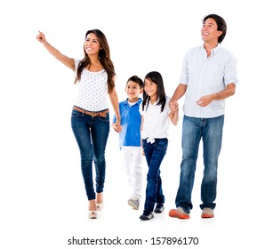 Happy family walking an pointing away - isolated over white background