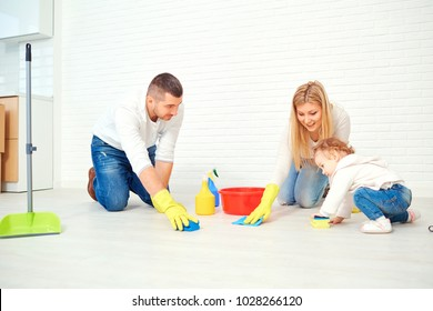 A happy family is washing the floor.