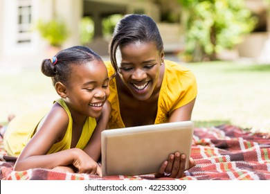 Happy family watching a laptop