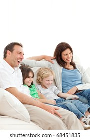 Happy family watching a movie together at home
