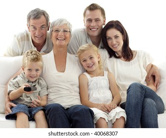 Happy family watching television in living-room at home