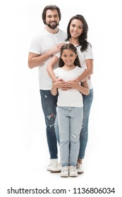 happy family in white shirts and jeans isolated on white