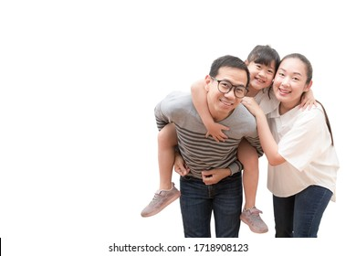 Happy family woman and a man with little child smiling and fun isolated over white background