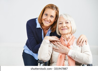 Happy family with woman and senior woman at home