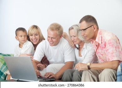 Happy family work together at home on computer
