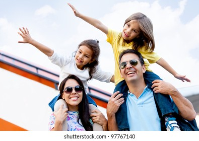 Happy family wth two kids traveling by airplane