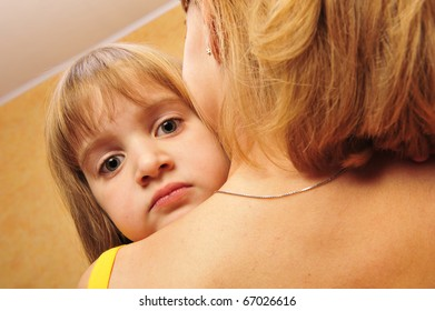 happy family, young beautiful mother and her little daughter indoor at home