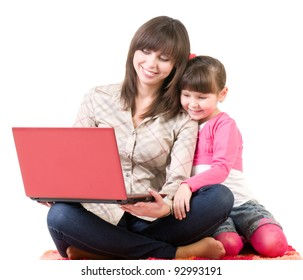 Happy family, young beautiful mother and her little daughter with laptop isolated over white
