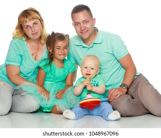 Happy family with young children. The concept of family happiness and development of children. Isolated on white background.