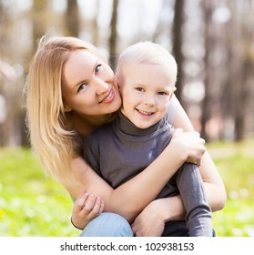 happy  family; young mother and her five year old son spending time outdoor on a summer day