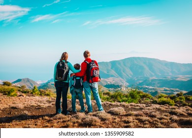 happy family-mom, dad and son-travel in nature