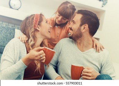Happy family-mother,father and daughter at home.