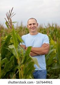Happy  farmer in field of corn