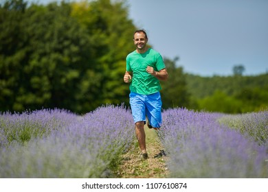 Happy farmer running in his lavender plantation in a sunny day