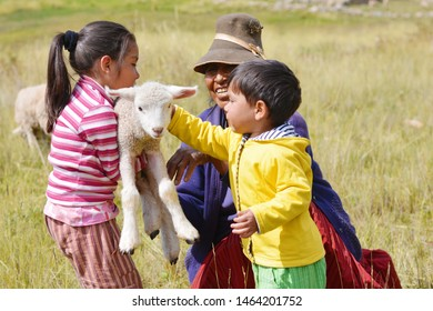 Happy farmers family with little lamb.
