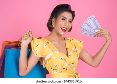 Happy Fashion beautiful woman hand holding dollar money for shopping
