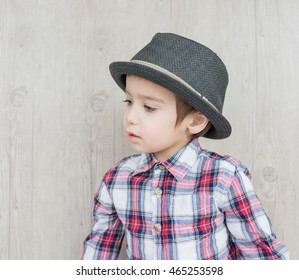 Happy fashionable kid portrait with a hat
