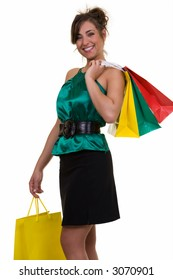 Happy fashionable woman holding up a bunch of colorful shopping bags standing on white background