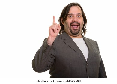 Happy fat Caucasian businessman smiling and pointing finger up isolated against white background