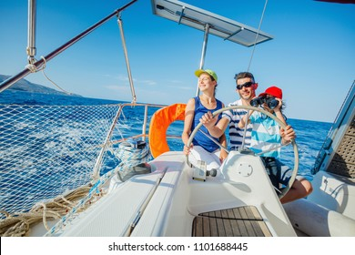 Happy father with adorable daughter and son resting on a big yacht