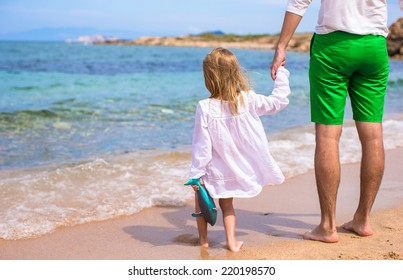 Happy father and adorable little daughter on the beach