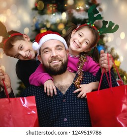 Happy father with children have a successful day of  Christmas shopping