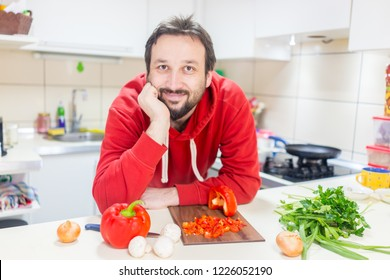 Happy father cook or making salad