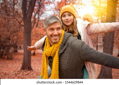 happy father with daughter in autumn park