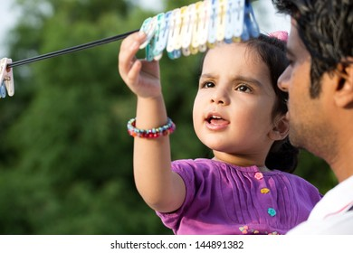 happy father and dauther in the outdoors, Indian man with his two year old daughter