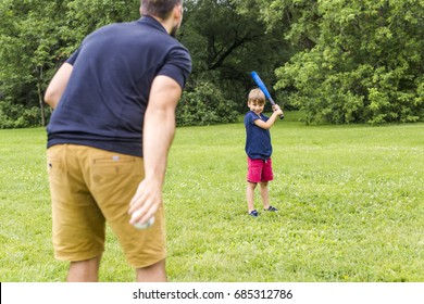 A Happy father and his son playing baseball