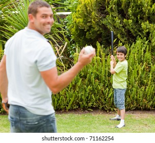 Happy father and his son playing baseball