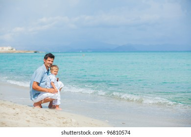 Happy father and his son playing happily at pretty beach