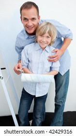 Happy father and his son renovating home after moving