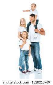 happy father holding on shoulders preteen pointing with finger near mother and sister on white