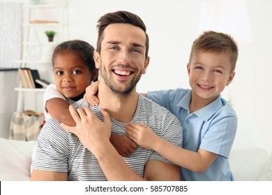 Happy father with interracial children