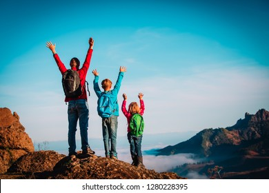 happy father and kids enjoy travel hiking in mountains