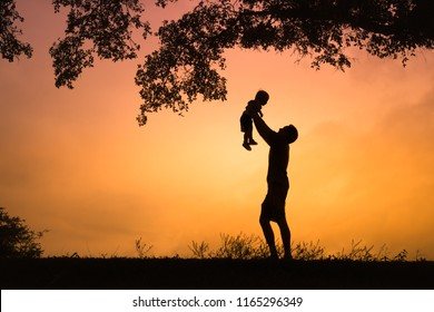 Happy father lifting son in the air. Family, childhood, fatherhood, and Fathers Day concept.