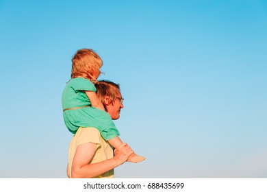 happy father and little daughter at blue sky