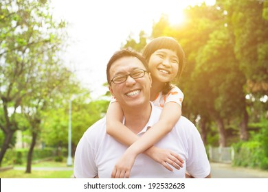 happy Father and little girl with sunset background
