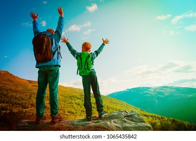 happy father and little son travel in mountains