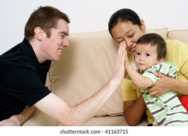 Happy father, mother and son together multi-ethnic family
